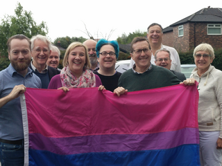 Campaigners holding the Bisexual flag