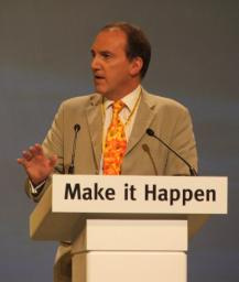 Simon Hughes MP at conference podium